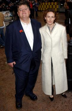 Robbie Coltrane with his companion at the world premiere of &quot;Harry Potter and the Chamber of Secrets&quot;.